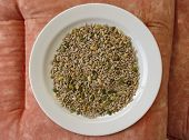 stock photo of sunflower-seeds  - Seed mixture of Pumpkin sunflower and sesame seeds