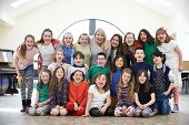 picture of drama  - Large Group Of Children With Teacher Enjoying Drama Workshop Together - JPG