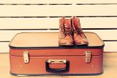 picture of shoes colorful  - Vintage suitcase with male shoes on wooden floor and color planks background - JPG
