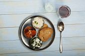 pic of indian food  - mixed indian thali food with rice on wood - JPG