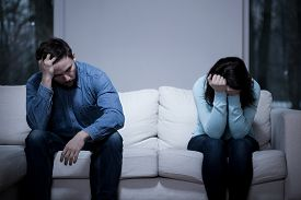 image of conflict couple  - Picture of young couple having difficulties in relationship - JPG