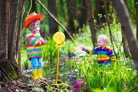 stock photo of baby frog  - Children playing outdoors - JPG