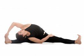 image of revolver  - Athletic young man doing yoga pilates stretching practice sitting in splits Parivrtta Upavistha Konasana Revolved Seated Angle Pose - JPG