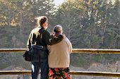 Tourist Couple Enjoying A View From Above poster