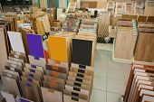 Assortment of laminated flooring samples in hardware store poster