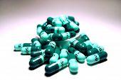 stock photo of mg  - Pile of green prescription pills sitting on table - JPG