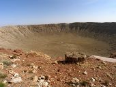 Meteor Crater In Arizona Against Clear Blue Sky