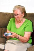 Grandmother Playing Video Game poster