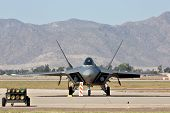 GLENDALE, AZ - MARCH 21: A U.S. Air Force F-22 Raptor fighter parked on the runway at the biennial a