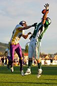 KORNEUBURG, AUSTRIA - APRIL 18: Austrian Football League:  WR Thomas Haider (#13, Dragons) and his t