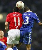 Ryan Giggs and Ashley Cole compete for a ball at the Champions League Final held at Luzhniki Stadium