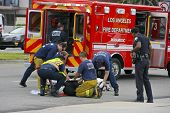 RESEDA, CALIFORNIA, USA - MAY 9: Firefighters help the victim of car accident on May 9, 2011 on Sher