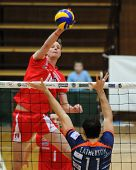 KAPOSVAR, HUNGARY - FEBRUARY 6: Krisztian Csoma strikes the ball at a Middle European League volleyb