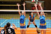 KAPOSVAR, HUNGARY - OCTOBER 31: Rebekra Rak (R) blocks the ball at the Hungarian NB I. League woman