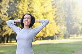 Portrait Of Mature Woman Before Or After Jog In The Park poster
