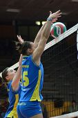 KAPOSVAR, HUNGARY - DECEMBER 19: Ajexandra Csaszar (L) blocks the ball at the Hungarian NB I. League