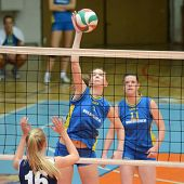 KAPOSVAR, HUNGARY - JANUARY 14: Rebeka Rak (C) strikes the ball at the Hungarian NB I. League woman