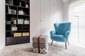 Reading Corner With Black Bookcase poster