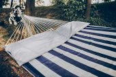 Stylish Striped Hammock Hanging Outdoors At Nature Resort Close-up, Blue And White Stipes On Comfort poster