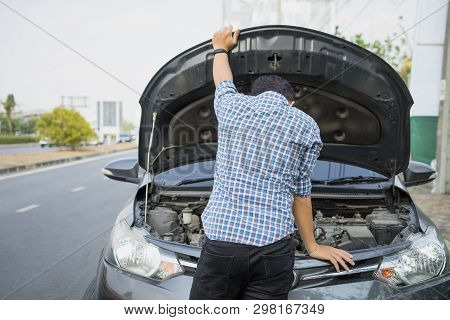 poster of Mechanic Wearing Gloves Open Car Hood Checking Car Engine Oil On The Road After Car Breakdown Proble