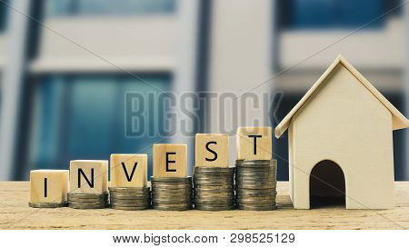 poster of Real Estate Investment, Money Savings For Buy New Home, Financial Wealth Management Concept. Wooden