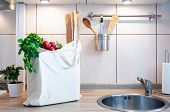 ecological shopping bag with fresh vegetables in bright kitchen no plastic poster