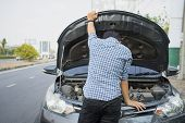 Mechanic Wearing Gloves Open Car Hood Checking Car Engine Oil On The Road After Car Breakdown Proble poster