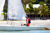 Man Sailing. Boy Learning To Sail On Sea Yacht. poster