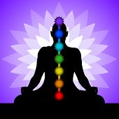 stock photo of chakra  - Silhouette of man in lotus position - JPG