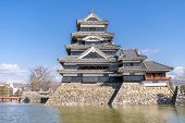 Matsumoto castle against blue sky in Matsumoto city in Nagano in Winter. Matsumoto Castle is an old  poster