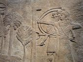 stock photo of babylonia  - Ancient Assyrian wall carvings of men with long hair - JPG