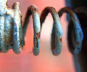 image of hematite  - rusty spring with paint peeling off - JPG