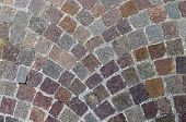stock photo of porphyry  - Typical italian cobblestone used to pave sidewalks or roads - JPG