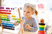 Adorable Cute Beautiful Little Toddler Girl Playing With Educational Wooden Rainbow Toy Pyramid And  poster