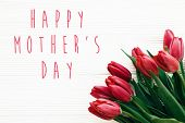 Happy Mothers Day Text And Beautiful Red Tulips On White Wooden Background Flat Lay. Happy Mother D poster