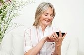 Senior woman playing an online game on smartphone
