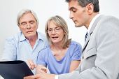 Senior couple getting financial advice from consultant at home