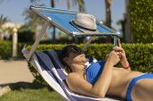 Summer Lifestyle Portrait Of Young Stunning Woman Lying On The Sunbed On The Beach Of The Tropical I poster