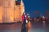 Luxury Woman In Evening Dress At Night City Going To Prom Party Fashion And Beauty Of Business Lady. poster
