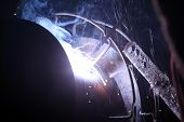 picture of tig  - man welding metal construction on a building site - JPG