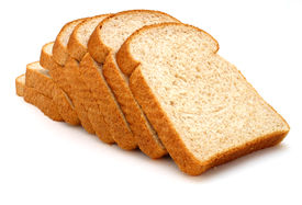 stock photo of fresh slice bread  - several slices of whole grain bread over a white surface - JPG