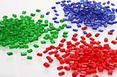 stock photo of thermoplastics  - red blue and green transparent polymer resin for injection moulding on white - JPG