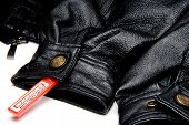 image of shoplifting  - An anti theft device on an expensive article of clothing - JPG