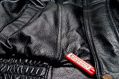 pic of shoplifting  - An anti theft device on an expensive article of clothing - JPG