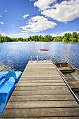stock photo of dock a lake  - Wooden dock on beautiful summer lake in Ontario Canada - JPG