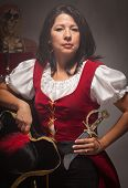 stock photo of wench  - Dramatic Female Pirate in a Dimly Lit Moody Scene - JPG