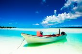 picture of deserted island  - Beautiful tropical lagoon on a deserted island with boat in foreground - JPG