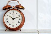 Vintage Copper Alarm Clock On The Mantelshelf