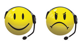 pic of smiley face  - Cheerful and angry smiley icon wearing a headset.