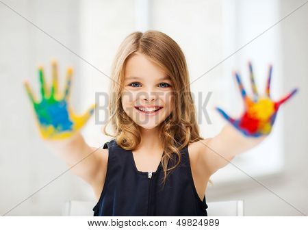 education, school, art and painitng concept - little student girl showing painted hands at school poster